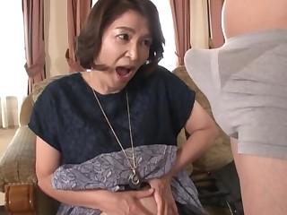 Mature Kitamura Toshiyo enjoys sucking her younger friend's dick